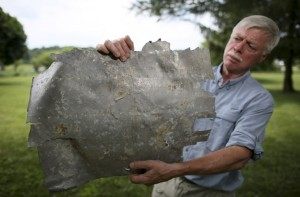 Ric Gillespie, executive director, International Group for Historic Aircraft Recovery (TIGHAR) holds a scrap of airplane wreckage, Thursday June 26, 2014, at his home in Oxford Pa., that is consistent the Lockheed Electra that Amelia Earhart was flying when she disappeared. Photo Credit: Joseph Kaczmarek
